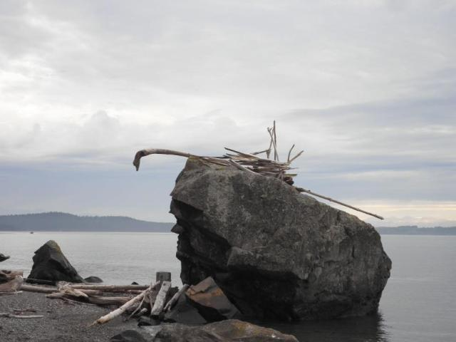"Typical ""structures"" using driftwood dragged off private property, which was hauled up onto Big Rock (which is also private property)."